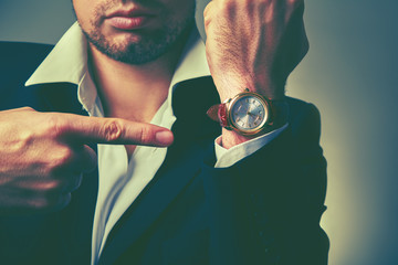 concept of time. watches on the arm of  businessman