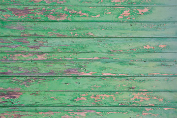 Green flaky painted wooden planks for grungy background.