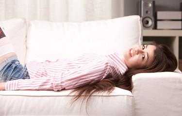 nice girl smiling on a sofa