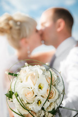 beautiful bouquet of the bride  with the wedding kissing couple