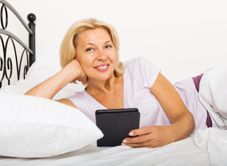 mature woman resting with ereader