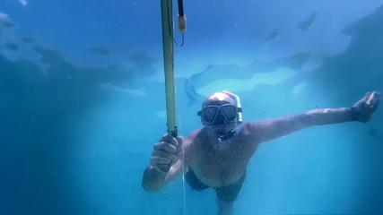 Underwater fisherman