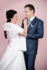 Bride and groom portrait in studio
