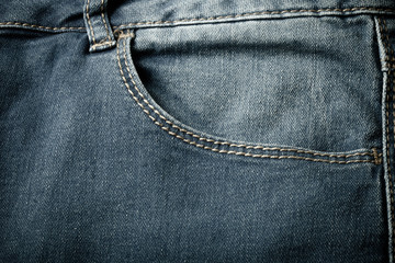 The pocket of jeans. Cloth background. Toned