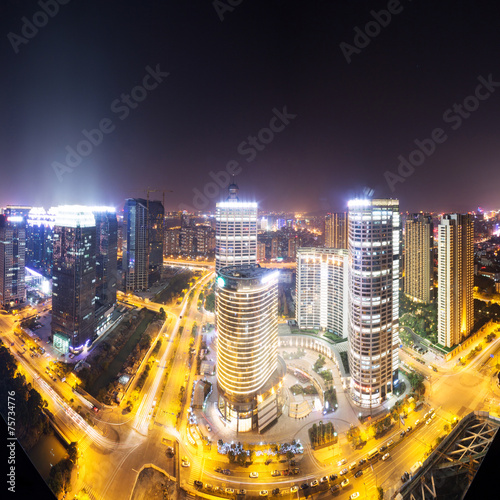 traffic trails and cityscape,buildings at night