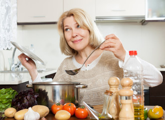 Positivity woman cooking  soup