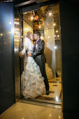 groom and the bride in the hotel elevator