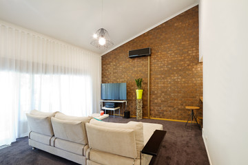Renovated 70s architectural apartment with angeld roofline