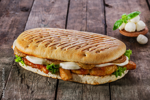grilled sandwich with chicken and mozzarella cheese - 75736154