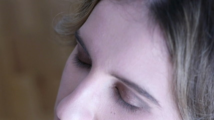 Makeup artist applying mascara on model