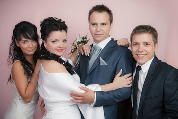 the groom, the bride and the best man with the witness