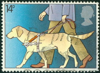 stamp shows Guide Dog Leading Blind Man