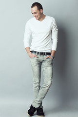 Male fashion concept. Fashionable young man standing