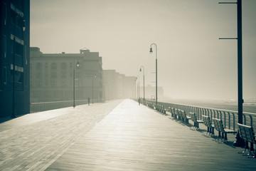 Morning fog on the ocean promenade