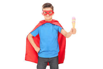 Child in superhero outfit holding an ice cream