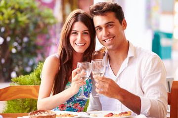 Young Couple Eating Meal Outdoors Together