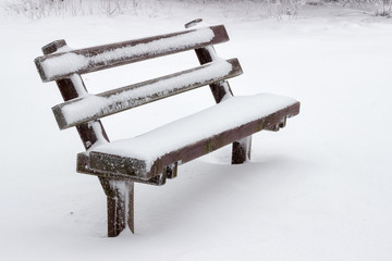 snow covered wooden sitting bench 2