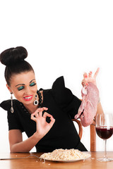 luxury woman with disgust holding a piece of raw meat
