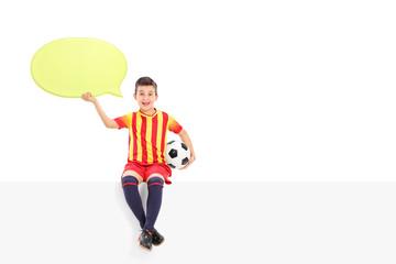 Junior football player holding a speech bubble