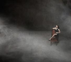 nice girl posing with long black dress