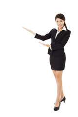 full length young smiling businesswoman with showing gesture