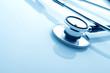 Stethoscope on blue background - 75741758