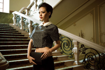 Business woman on the stairs
