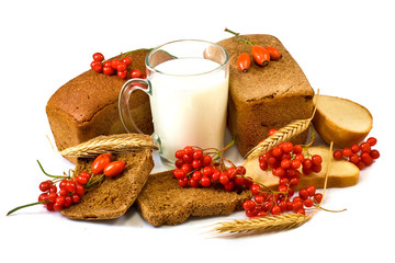 berries, milk and bread on white background