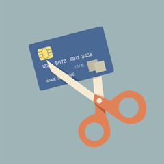 cutting up credit card with scissors