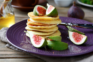 stack of pancakes with figs and honey