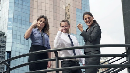 Successful, happy businesspeople in the city