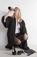 Mature female university student drinking beer