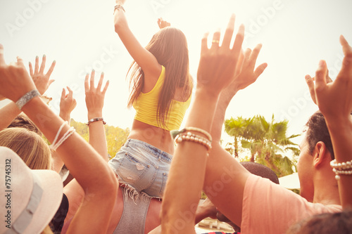 Group Of Young People Enjoying Outdoor Music Festival - 75745312