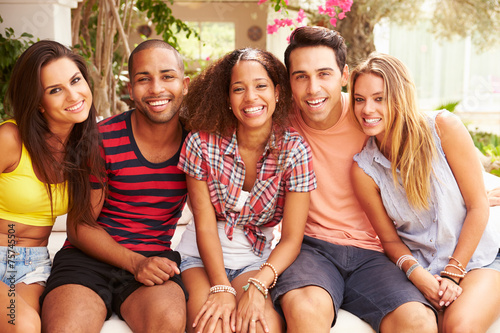 canvas print picture Group Of Friends Relaxing Outdoors On Holiday Together