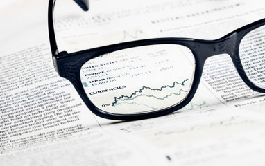 financial chart and graph currencies see through glasses lens