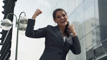 Successful, happy businesswoman in the city