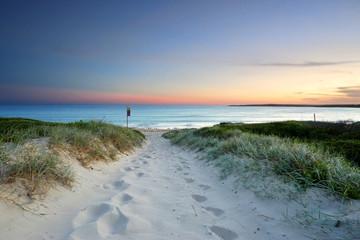 Sandy beach trail at dusk sundown Australia