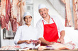 canvas print picture - Happy Butchers Working At Counter