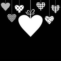 Valentine card with hanging hearts on black background