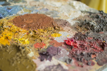 Detail of palette with oil colors