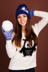 Teenager girl is holding snowball