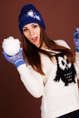 Teenager girl with snowball