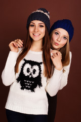 Two teenager girls friends in winter clothes