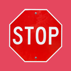 Bright stop sign on a red background