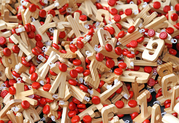 letters in wood with Red wheels to compose words and name of chi