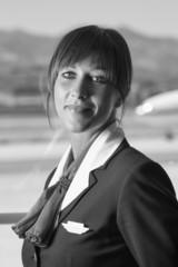 Italy, Sardinia, Olbia Airport, flight stewardess portrait