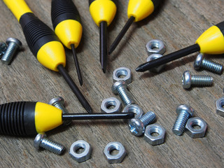 hand tools, yellow screwdriver set on wooden background