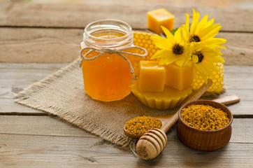 Still life from honey,  wax, honeycombs,flawers and pollen granu