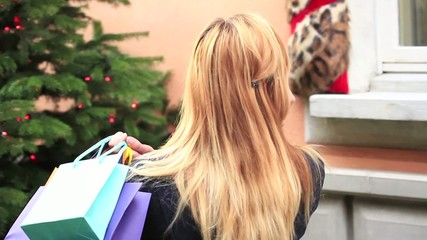 Woman shopping for christmas-On the phone