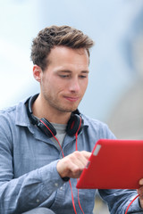 Urban young professional man on tablet